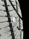 Screw in tire into rubber isolated towards black background Stock Image