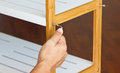 Screw Up Wooden Shelf With Hex Wrench. Royalty Free Stock Photo
