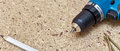 Screwdriver on chipboard cordless and screws Stock Image
