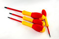 Screwdriver four yellow red lying steel Royalty Free Stock Image