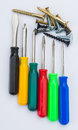 Screwdriver set different colors closeup on white background Stock Photos