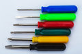 Screwdriver set different colors closeup on white background Royalty Free Stock Photography