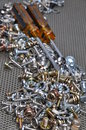 Screwdrivers and components bolts, nuts, washers, screws Royalty Free Stock Photo
