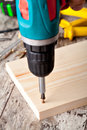 Screwing a screw into wood with screwdriver Stock Image