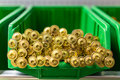 Screws many yellow in the green plastic box Royalty Free Stock Images