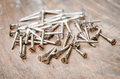 Screws on the wood board. Royalty Free Stock Photo