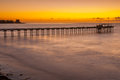 Scripps pier la jolla california with orange glow of sunset Royalty Free Stock Image