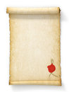 Scroll of old yellowed paper with a wax seal Royalty Free Stock Photo