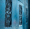 Scrollwork on teal blue doors historic new orleans building with and antique ironwork Stock Image