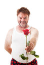 Scruffy guy with single rose looking man in his underwear holding out a red for his sweetheart isolated on white Royalty Free Stock Images