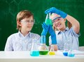 Scrutiny two children looking at tube with chemical liquid Royalty Free Stock Photo