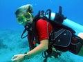 Scuba diver enjoys sunny dive Royalty Free Stock Photo