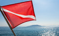 Scuba divers flag waving on a boat Royalty Free Stock Photo