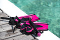 Scuba mask with pink flippers on wooden pier background Stock Photo