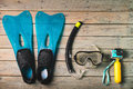Scuba mask, snorkel and blue flippers with sports camcorder. Royalty Free Stock Photo