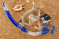 Scuba mask and snorkel on the sand. Action camera. Royalty Free Stock Photo