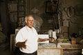 Sculptor tells about his studio senior Stock Photo