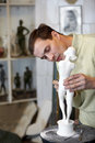 Sculptor works attentively in studio Stock Photos