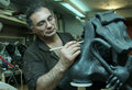 Sculptor the works in a workshop Royalty Free Stock Images