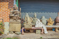 Sculptural images of deities are sold