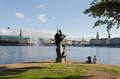 Sculpture alster lake hamburg germany september a group of young people seated next to a at the edge of on september in hamburg Stock Image