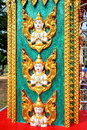Sculpture of angel at a pole in a temple in thailand normally there are many decoration wall roof and everywhere thai this is one Stock Photo