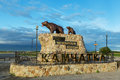 Sculpture of bears on the monument with the inscription: Here begins Russia - Kamchatka