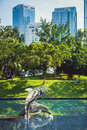 Sculpture of dolphins in the city park on the background of buildings. City art. Kuala Lumpur, Malaysia. Royalty Free Stock Photo
