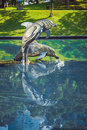Sculpture of dolphins in the city park. Kuala Lumpur, Malaysia. Royalty Free Stock Photo
