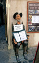 Sculpture of don quixote keeps the menu in front of the restaura toledo spain october holding a restaurant inscription spanish do Royalty Free Stock Photo