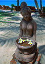 Sculpture with flowers Stock Photo