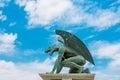 Sculpture of gargoyle on blue sky background Stock Photos