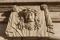 Sculpture of greece personage cut out from a stone face ancient Royalty Free Stock Photos