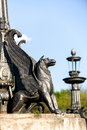 Sculpture of griffin on stone pedestal in autumn sunny day Stock Photography