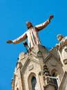 Sculpture of jesus on emple of sagrat cor at tibidabo in barcelona Stock Image