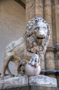 Sculpture of Lion with ball at the Loggia of Lanzi Stock Photos