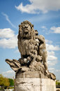 The sculpture Lion steered by a child at Alexander III bridge Royalty Free Stock Photo