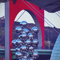 Sculpture next to the guggenheim museum bilbao big tree consisting of stainless steel balls with reflections by anish kapoor in Stock Photography