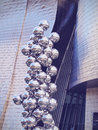 Sculpture next to the guggenheim museum bilbao big tree consisting of stainless steel balls with reflections by anish kapoor in Stock Photos
