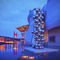 Sculpture next to the guggenheim museum bilbao night view of big tree consisting of stainless steel balls with reflections by Royalty Free Stock Photography