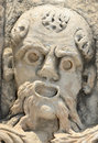 Sculpture of old man ancient greek the face an angry with beard shouting used to decorate a theatre Royalty Free Stock Photo