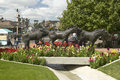 A sculpture of running horses and beautiful spring flowers in Old Town of Scottsdale, Arizona Royalty Free Stock Photo