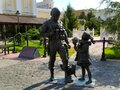 A sculpture of a soldier in camouflage and a girl with a cat, polite people, in Simferopol, Crimea. Travel concept. Horizontally.