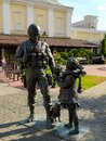 A sculpture of a soldier in camouflage and a girl with a cat, polite people, in Simferopol, Crimea. Travel concept. Mobile photo