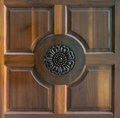 Sculpture on teak wood door the picture of design that popular in thai style house Stock Images