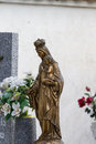 Sculpture of the virgin mary in a cemetery old with graves spanish holy place Royalty Free Stock Photography