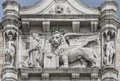Sculpture of winged  lion of Venice with priest and book, Venice Royalty Free Stock Photo