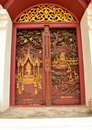Sculpture wood for architecture and carving temple doors thailand handmade story of religious literature on and decorated with Royalty Free Stock Images
