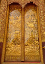 Sculpture wood for architecture and carving temple doors thailand handmade story of religious literature on and decorated with Stock Photo