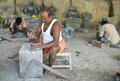 Sculpture workshop india and three sculptors in mahabalipuram Stock Images